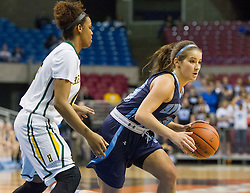 Spring Valley guard Sarah Kelly (13) drives the ball past Huntington guard Dazha Congleton (15) during a first round game at the Charleston Civic Center.