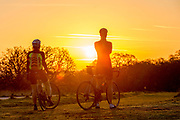 UNITED KINGDOM, London: 18 April 2018 Cyclists stop and enjoy the view during a warm sunrise in Richmond Park this morning. Londoners will be enjoying the weather today as temperatures are set to reach a high of 25 degrees Celsius in the capital. Rick Findler / Story Picture Agency