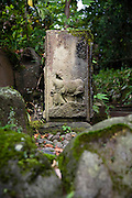 Photo shows  a hand-carved stone well in the Kakubuen gardens of the Honma Museum of Art in Sakata, Yamagata Prefecture, Japan, on July 06, 2012. Photographer: Robert Gilhooly