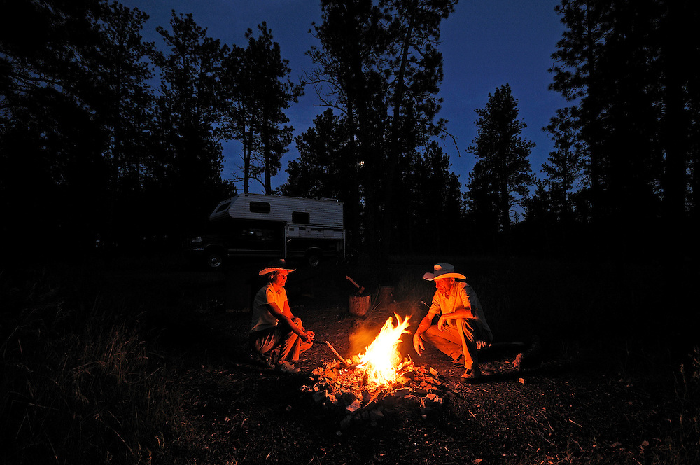 Camper on Custer National Forest Campground, evening Bonfire, near Ashland,  Montana, USA