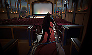 Kathy Piechotta vacuums the aisles of the 100-year-old Patricia Theatre prior to an afternoon matinee in Powell River, BC (2013)