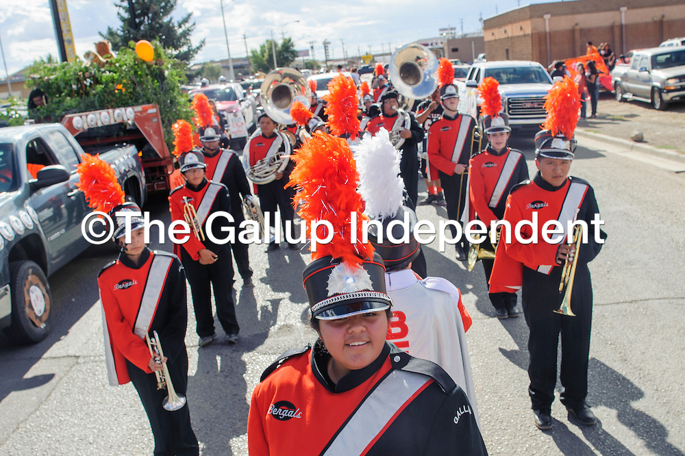 091914       Adron Gardner/Independent<br /> <br /> The Gallup High School marching band forms up for the Bengal Homecoming parade on Coal Avenue in Gallup Friday.