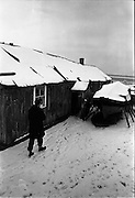 13/01/1963<br /> 01/13/1963<br /> 13 January 1963<br /> Snow scenes from Kiliney and Dun Laoghaire, Co. Dublin. View of boat and shed at Dun Laoghaire.