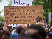 06 JUNE 2020 - DES MOINES, IOWA: A sign about US President Donald Trump at a Black Lives Matter march in Des Moines. More than 1,000 protesters marched through downtown Des Moines to the state capitol to demand an end to police violence against Black people. The march was organized by Black Lives Matter and honored George Floyd, the unarmed Black man killed by Minneapolis police on 25 May 2020.         PHOTO BY JACK KURTZ