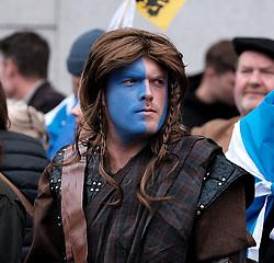 All Under One Banner March, Edinburgh, 5 October 2019<br /> <br /> Pictured: Marchers make their way to the start past the Parliament<br /> <br /> Alex Todd | Edinburgh Elite media