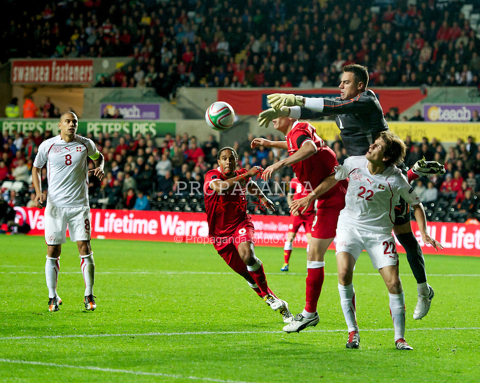 SWANSEA, WALES - Friday, October 7, 2011: Wales' Steve Morison challenges Switzerland's goalkeeper Diego Benaglio and Timm Klose during the UEFA Euro 2012 Qualifying Group G match at the Liberty Stadium. (Pic by Chris Brunskill/Propaganda)