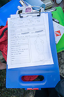 Manatee Health Assessments, Kings Bay, Crystal River, Citrus County, Florida USA. November 10, 2011 pm. Researchers from several federal and state agencies and other partners work together to gather data during the manatee capture and health assessments. Official form filled out by Cathy Beck, Wildlife Biologist with US Geological Survey's Sirenia Project, documents various manatee data including markings or scars.