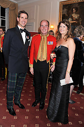 Left to right, PRINCE PAVLOS OF GREECE, LIEUTENANT COLONEL JONATHAN BARTHOLOMEW and ALEXA JAGO at a dinner in aid of Caring For Courage - The Royal Scots Dragoon Guards Afghanistan Welfare Appeal held at The Royal Hospital Chelsea, London SW3 on 20th October 2011.