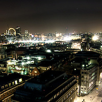 View towards St Pauls Cathedral also with The London Eye and Tate Modern in view at night