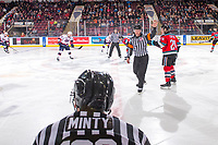 KELOWNA, CANADA - NOVEMBER 21:  Referee Brett Iverson calls to the benches for the face off at the Kelowna Rockets against the Regina Pats  on November 21, 2018 at Prospera Place in Kelowna, British Columbia, Canada.  (Photo by Marissa Baecker/Shoot the Breeze)