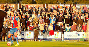 The crowd struggle with the sun during the Pre-Season Friendly match between Bromley and Crystal Palace at the Courage Stadium, Bromley, United Kingdom on 30 July 2015. Photo by Michael Hulf.