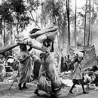 Goma, Zaire, July 19th 1994. 'The problem has moved up the road ', said the UN spokesman , referring to the million plus people who crossed the border at the week-end, the guilty and their communities fleeing the genocide in Rwanda.