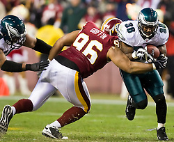 Philadelphia Eagles running back Brian Westbrook (36) is wrapped up by Washington Redskins defensive tackle Cornelius Griffin (96).  The Washington Redskins defeated the Philadelphia Eagles 10-3 in an NFL football game held at Fedex Field in Landover, Maryland on Sunday, December 21, 2008.