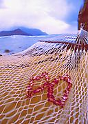 Image of Hawaiian leis on hammock overlooking Bali Hai on Kauai, Hawaii, Hawaiian Islands