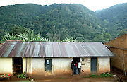 Residents and housing just outside Bwindi National Park.Uganda, Africa.