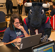 Houston Texans mascot Toro checks out a student's progress during the Houston launch of the Character Playbook, a joint initiative of the NFL and the United Way Worldwide at Pilgrim Academy, February 3, 2017.