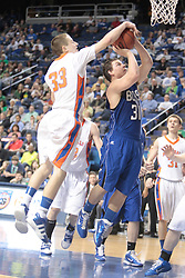 Marshall County's Cole Nelson, left, blocks a shot by Bell County's John Dudley Hilton in the first half. Marshall County hosted Bell County in 8th game of  the 2011 PNC/ KHSAA Boys Sweet 16, Thursday, March 17, 2011. Photo by Jonathan Palmer