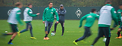 25.10.2014, Trainingscenter, Bremen, GER, 1. FBL, SV Werder Bremen, im Bild Robin Dutt (Cheftrainer SV Werder Bremen) auf dem Platz mit verschränkten Armen, aufgenommen mit bewusst länger gewählter Verschlusszeit // during a Trainingssession of German Bundesliga Club SV Werder Bremen at the Trainingscenter in Bremen, Germany on 2014/10/25. EXPA Pictures © 2014, PhotoCredit: EXPA/ Andreas Gumz<br /> <br /> *****ATTENTION - OUT of GER*****