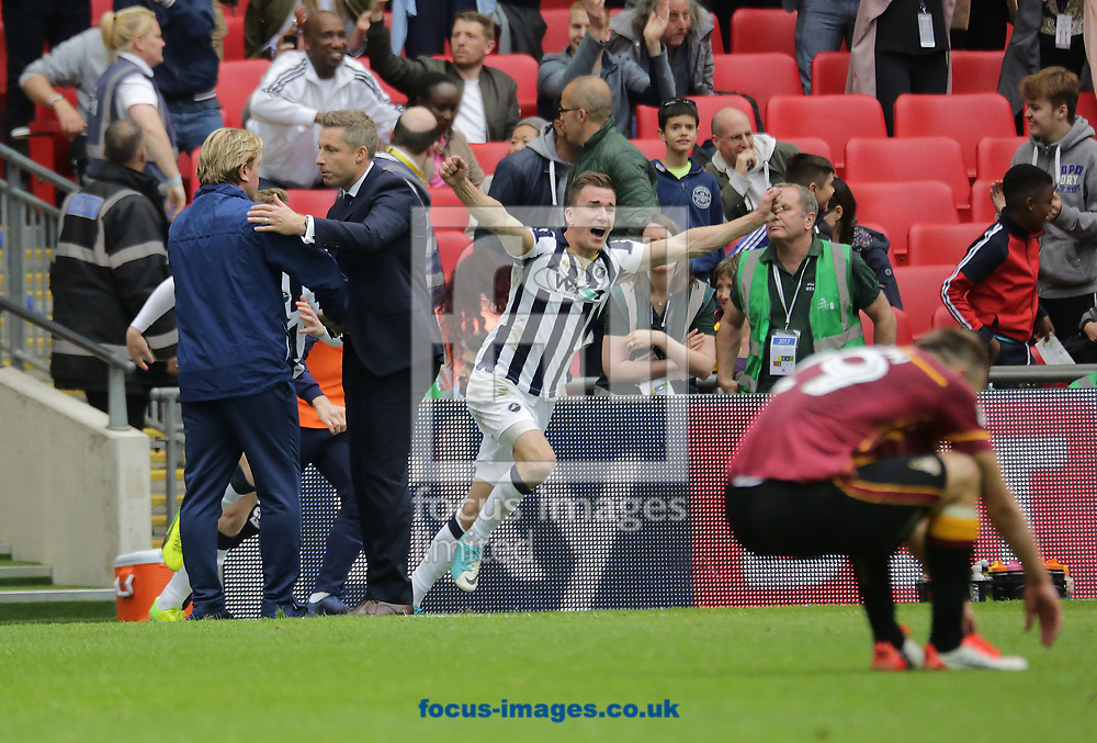 Millwall boss Neil Harris shakes hands with Bradford City's Stuart McCall after winning the Sky Bet League 1 play-off final at Wembley Stadium, London<br /> Picture by Glenn Sparkes/Focus Images Ltd 07939664067<br /> 20/05/2017