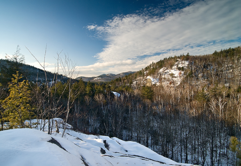Adirondacks, NY.<br /> <br /> A sketchy trail in the Dix Wilderness leads to this overlook near Moss Ponds.  From here the trail drops and splits to a marshy area west, or a ridgeline walk east, but there are no markers and few visitors.