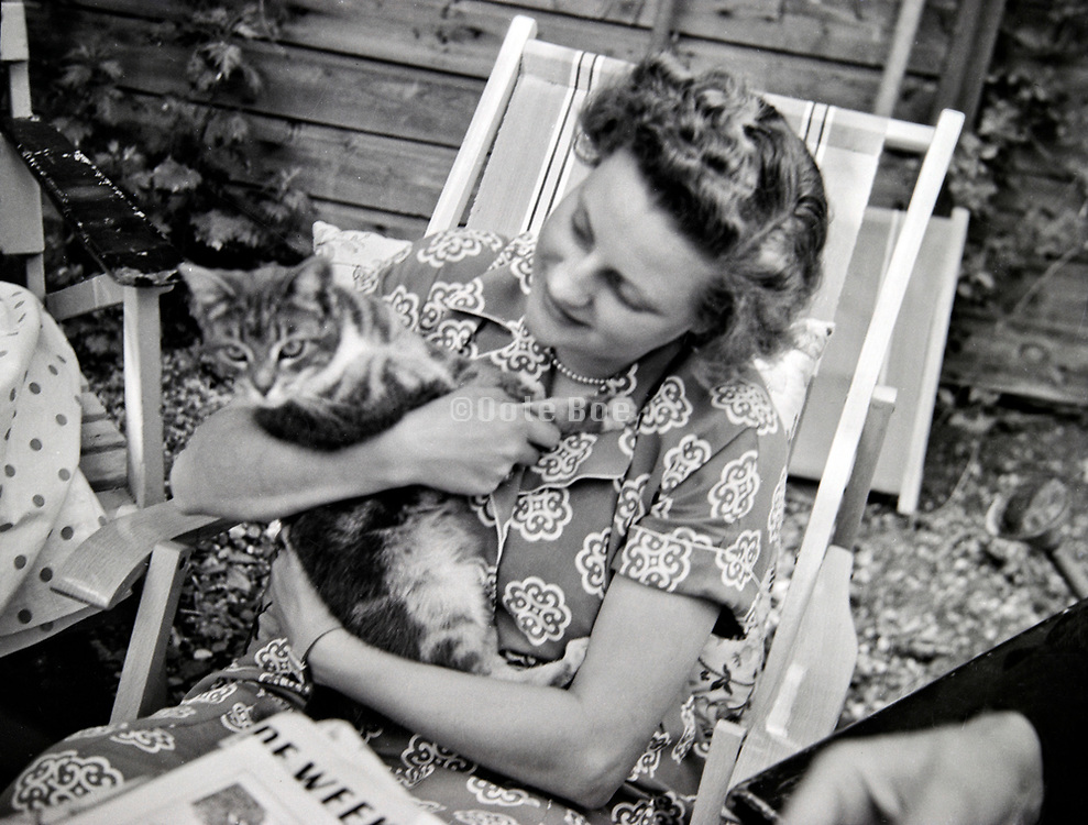 woman holding cat in her arms Netherlands 1950s