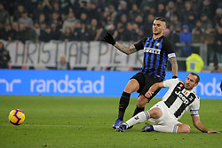 December 7, 2018 - Turin, Turin, Italy - Giorgio Chiellini #3 of Juventus FC competes for the ball with Mauro Icardi #9 of FC Internazionale Milano during the serie A match between Juventus FC and FC Internazionale Milano at Allianz Stadium on December 07, 2018 in Turin, Italy. (Credit Image: © Giuseppe Cottini/NurPhoto via ZUMA Press)