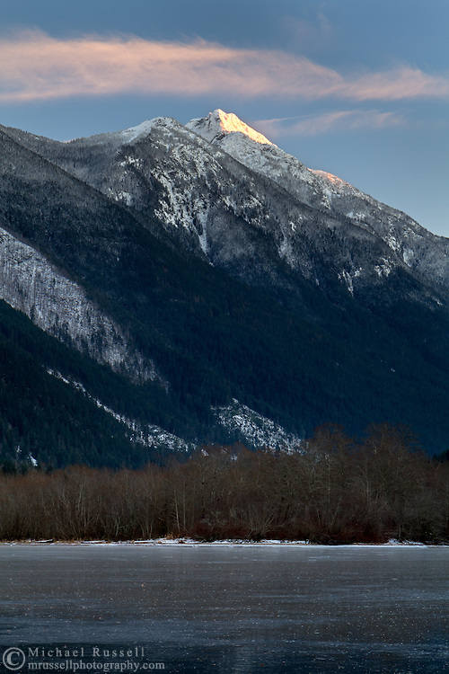 Mount Grant at sunset from a frozen Silver Lake in Silver Lake Provincial Park near Hope, British Columbia, Canada.