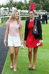Milliner Cara Meechan (left) and Camilla Henderson, the daughter of trainer Nicky Henderson in the parade ring  on the second day of Glorious Goodwood<br /> London,  Wednesday, 31st July 2013<br /> Picture by Stephen Lock / i-Images