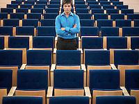 Businessman standing alone in Auditorium portrait
