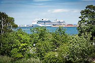 A passenger cruise liner docks in Copenhagen's harbour, as seen from the ramparts of Kastellet - the city's 18th century fortress