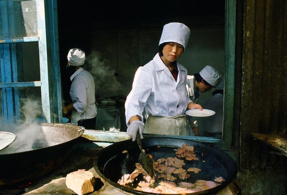 Cooking snacks at Peking Market, China. RESERVED USE - NOT FOR DOWNLOAD -  FOR USE CONTACT TIM GRAHAM