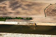 Nederland, Noord-Brabant, Den Bosch, 09-05-2013; werkzaamheden aan de Zuid-Willemsvaart. Het kanaal wordt verbreed, uitgegraven en omgelegd - zodat de binnenstad van Den Bosch vermeden kan worden. Het gaat niet alleen om een omlegging, maar ook om een opwaardering zodat grote schepen van het kanaal gebruik kunnen blijven maken.<br /> View on works on the Zuid-Willemsvaart (channel), shovel dredging .<br /> luchtfoto (toeslag op standard tarieven);<br /> aerial photo (additional fee required);<br /> copyright foto/photo Siebe Swart.