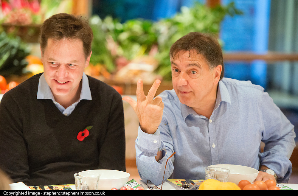 © Licensed to London News Pictures. 03/11/2014. Oxford, UK. NICK CLEGG and RAYMOND BLANC (R) talk to local school children over breakfast.  To celebrate National School Meals Week (3-7 November), the Deputy Prime Minister, Nick Clegg, joins school children at Brasserie Blanc in Oxford to get some top cooking tips from Raymond Blanc. The visit is part of a larger national effort to raise awareness of and enhance children's relationship with food. The Deputy Prime Minister has called on celebrity chefs to lead the way by joining forces with school cooks to promote the great school lunch. School cooks up and down the country will be taking their skills out of the school kitchen to showcase to parents and pupils the variety and quality of food now being served in schools. National School Meals Week comes just months after the launch of free school meals for 2.8 million primary school children and the introduction of cooking in the curriculum.. Photo credit : Stephen Simpson/LNP