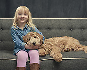 Girl and Doodle on the couch