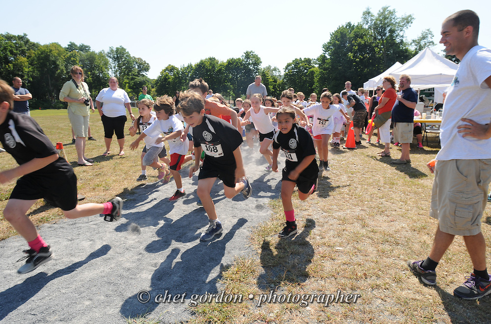 Young runners leave the starting line for the Children's Fun Run during the Greenwood Lake Inaugural 5K Run in Greenwood Lake, NY on Saturday, August 9, 2014.  © Chet Gordon/THE IMAGE WORKS