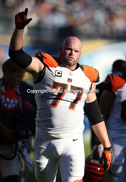 Cincinnati Bengals tackle Andrew Whitworth (77) celebrates by waving his arm in the air after the NFL week 13 football game against the San Diego Chargers on Sunday, Dec. 1, 2013 in San Diego. The Bengals won the game 17-10. ©Paul Anthony Spinelli
