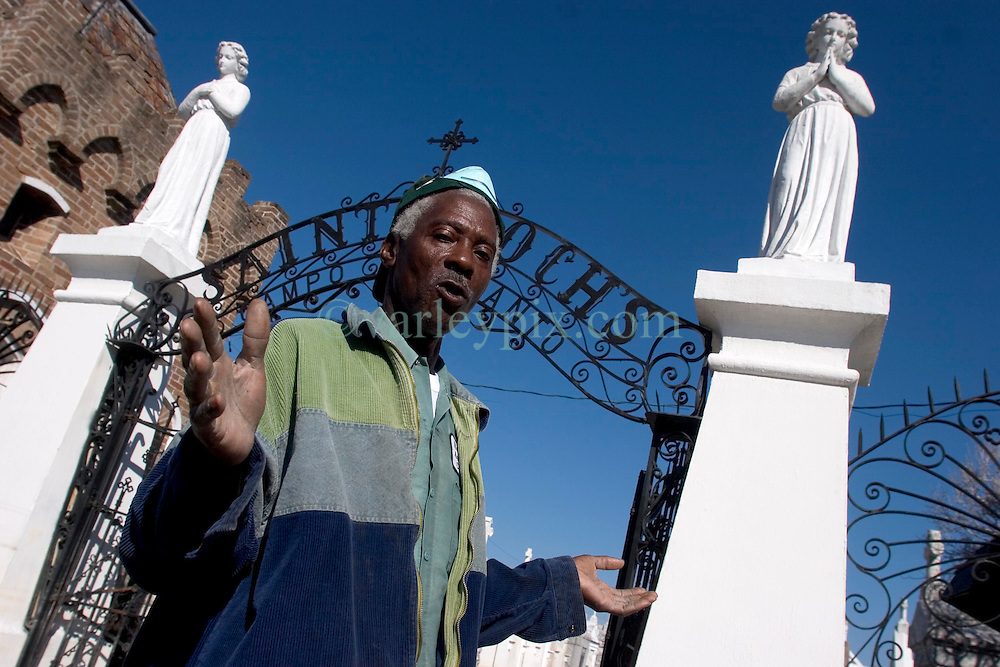 25 Oct,  2005.New Orleans, Louisiana. Hurricane Katrina aftermath.<br /> Jackie Muse, curator, custodian and carer of the cemetery tells his evacuation story outside the shrine at St. Roch's cemetery. <br /> Photo; &copy;Charlie Varley/varleypix.com