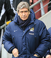 Manuel Pellegrini manager of Manchester City during the Barclays Premier League match at the KC Stadium, Kingston upon Hull<br /> Picture by Richard Gould/Focus Images Ltd +44 7855 403186<br /> 15/03/2014
