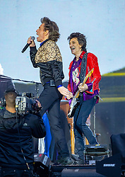 Mick Jagger and Ronnie Wood of The Rolling Stones performs on stage at Murrayfield Stadium in Edinburgh, Scotland.