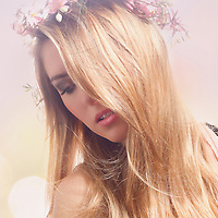 Close up of female with blonde hair with flowers in her hair