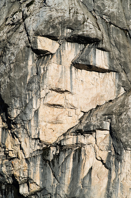 &quot;face&quot; in the wall of mount Prisojnik, rock formation &quot;Ajdovska deklica&quot;<br /> seen from Vrsic mountain road<br /> Triglav National Park, Slovenia<br /> June 2009