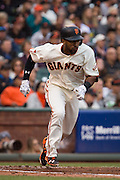 San Francisco Giants shortstop Eduardo Nunez (10) runs to first base after hitting the ball against the New York Mets at AT&T Park in San Francisco, Calif., on August 21, 2016. (Stan Olszewski/Special to S.F. Examiner)
