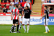 Michael Bostwick (16) of Lincoln City has words to referee Craig Hicks after he awarded a free kick to Exeter during the EFL Sky Bet League 2 match between Exeter City and Lincoln City at St James' Park, Exeter, England on 19 August 2017. Photo by Graham Hunt.