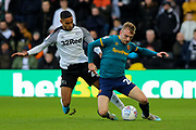Derby County defender Max Lowe challenges Hull City forward Jarrod Bowen during the EFL Sky Bet Championship match between Derby County and Hull City at the Pride Park, Derby, England on 18 January 2020.