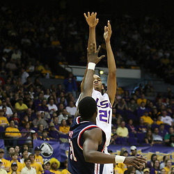 14 February 2009 LSU center Chris Johnson (21) shoots over Malcolm White (21) of Ole Miss during a NCAA basketball game between SEC rivals the Ole Miss Rebels and the LSU Tigers at the Pete Maravich Assembly Center in Baton Rouge, LA.