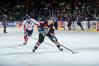 KELOWNA, CANADA, OCTOBER 16 -  Zach Franko #9 of the Kelowna Rockets skates with the puck against the Lethbridge Hurricanes on Wednesday, October 16, 2013 at Prospera Place in Kelowna, British Columbia (photo by Marissa Baecker/Getty Images)***Local Caption***