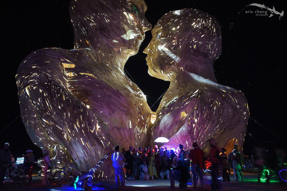 Embrace, at night. Burning Man 2014.