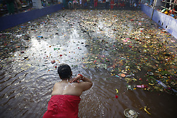 April 26, 2017 - Kathmandu, Nepal - A Nepalese devotee takes a holy bath in memory of her departed mother on Mothers Day in Kathmandu. (Credit Image: © Skanda Gautam via ZUMA Wire)