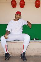 Baseball pitcher sitting in dugout (portrait)