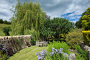English cottage garden in Swinbrook in The Cotswolds, Oxfordshire, UK